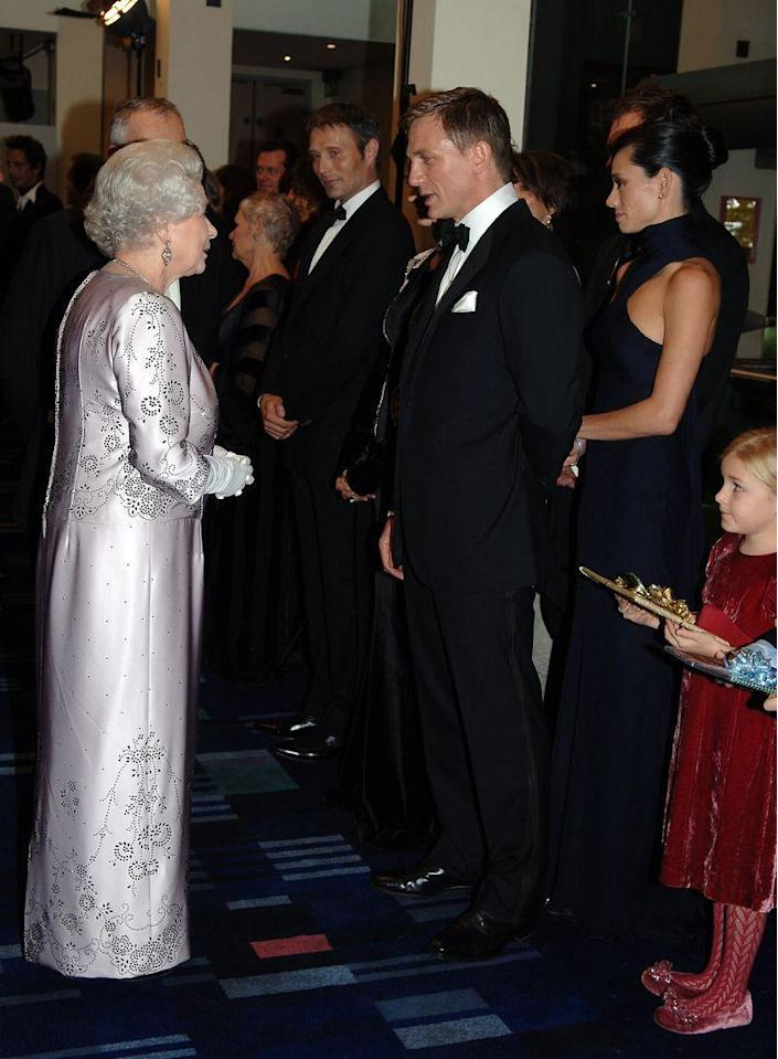 <p>We wonder if Queen Elizabeth is as charmed by Daniel Craig in a sharp tuxedo as I am. Judging by the look of their interaction here, I'd say yes. </p>