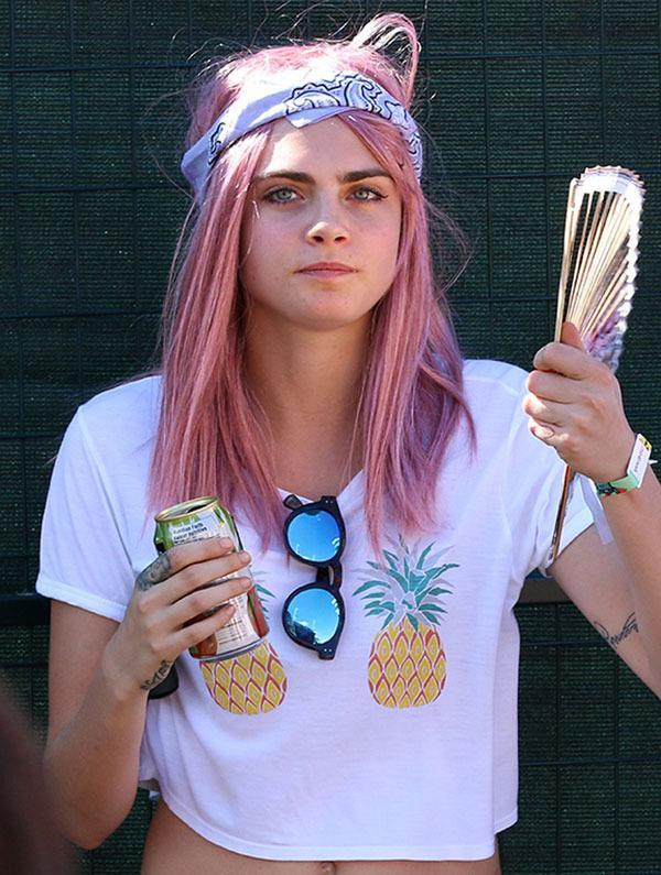 <br>Cara stepped out over the weekend showing off a new pink 'do! Now while we're not sure if it's a permanent change, or just a wig, we think it totally suits her!