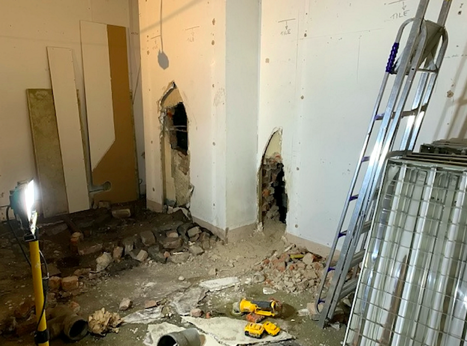 The hole was drilled from an unused shop into the WHSmith next door. (SWNS)