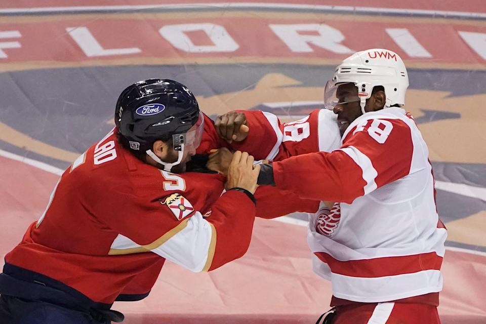 Florida Panthers defenseman Aaron Ekblad, left, and Detroit Red Wings right wing Givani Smith fight during the third period Sunday, Feb. 7, 2021, in Sunrise, Fla.