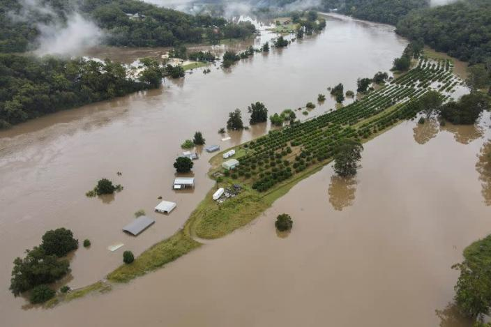 Drone picture of orange orchards and houses that are submerged near Hawkesbury River in northwestern Sydney