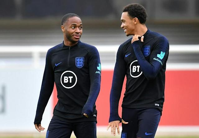 Friends turned foes: England teammates Raheem Sterling (left) and Trent Alexander-Arnold (right) will face off on Sunday (AFP Photo/Paul ELLIS)