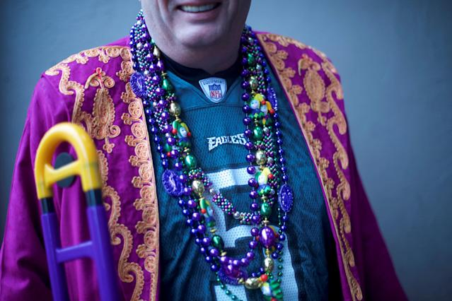 A reveler wears Mardi Gras themed beads at a party before the Philadelphia Eagles play with the New England Patriots in Super Bowl LII in Philadelphia, Pennsylvania, U.S., February 4, 2018. REUTERS/Mark Makela