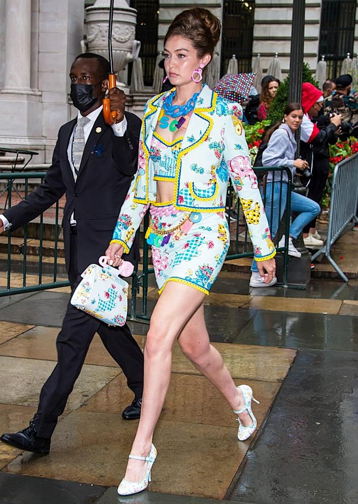 <p>Gigi Hadid heads to the Moschino by Jeremy Scott Spring Summer 2022 fashion show at Bryant Park on Sept. 9 in N.Y.C.</p>