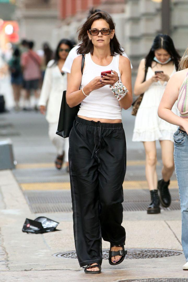 Katie Holmes heads to dinner wearing relaxed attire in New York, July 27. - Credit: Christopher Peterson/Splash News