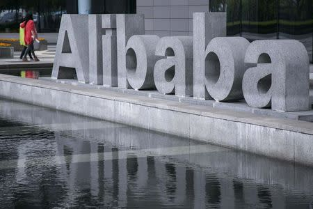 People walk at the headquarters of Alibaba in Hangzhou