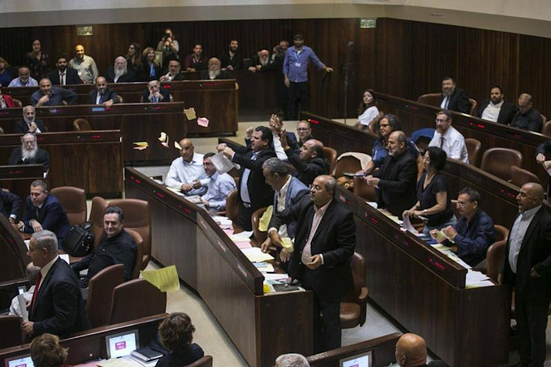 Arab lawmakers stand up in protest (AP)