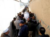 Relatives carry the body of one of female judges shot dead by unknown gunmen in Kabul
