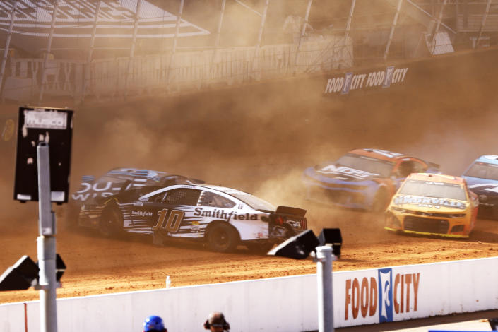Driver Aric Almirola (10) collides with Anthony Alfredo (38) during a NASCAR Cup Series auto race, Monday, March 29, 2021, in Bristol, Tenn. (AP Photo/Wade Payne)