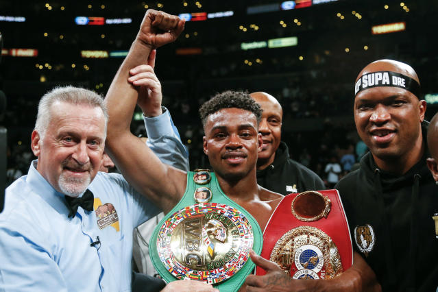 Errol Spence Jr., center, celebrates his victory over Shawn Porter during the WBC & IBF World Welterweight Championship boxing match, Saturday, Sept. 28, 2019, in Los Angeles. (AP Photo/Ringo H.W. Chiu)