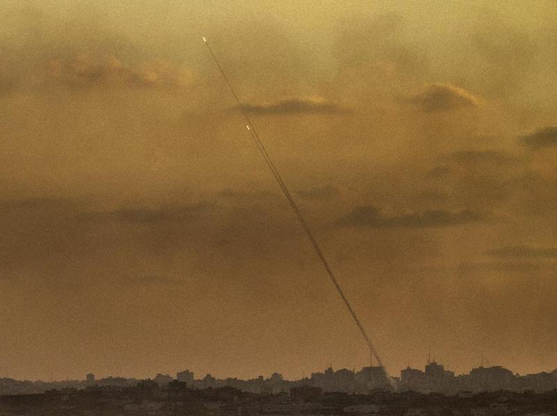 A picture taken from the southern Israeli Gaza border shows rockets being fired from the Gaza strip into Israel, on July 24, 2014