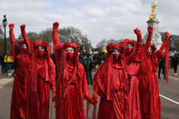 Extinction Rebellion activists perform during a 'Kill the Bill' protest in London, Saturday, April 3, 2021. The demonstration is against the contentious Police, Crime, Sentencing and Courts Bill, which is currently going through Parliament and would give police stronger powers to restrict protests. (AP Photo/Alberto Pezzali)