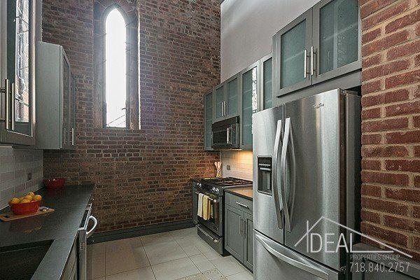 """This is the former <a href=""""http://www.brooklyneagle.com/articles/milestones-faith-fort-greene-church-renovation"""" target=""""_blank"""">St. Mark's Protestant Episcopal Church</a>, a1888 Gothic Revival churchlocated at 232 Adelphi Street in Fort Greene, Brooklyn. The building, which has been divided into 12 separate homes, still <a href=""""http://ny.curbed.com/2015/1/27/9998452/splendid-rentals-carved-from-brooklyn-church-to-ask-2995"""" target=""""_blank"""">bears</a> signs of its former use as a sacred space -- with stained glass windows, domed ceilings, and exposed brick.<br /><br /><i>Scroll down for images from inside the renovated St. Mark's Protestant EpiscopalChurch.</i>"""