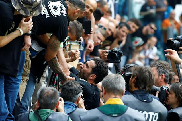 Soccer Football - Serie A - Juventus vs Hellas Verona - Allianz Stadium, Turin, Italy - May 19, 2018 Juventus' Gianluigi Buffon with fans before the match REUTERS/Stefano Rellandini