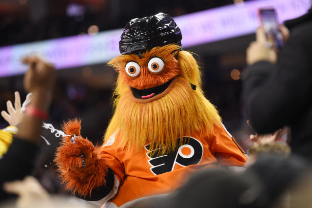 FILE In this Monday, Jan. 13, 2020, file photo, Philadelphia Flyers' mascot Gritty performs during an NHL hockey game in Philadelphia. Edmonton Oilers captain Connor McDavid is still regarded as the NHL's top forward, while peers consider Pittsburgh's Sidney Crosby the game's most complete player. When it comes to mascots, the Philadelphia Flyers' Gritty was the runaway favorite for a second straight year. (AP Photo/Derik Hamilton, File)