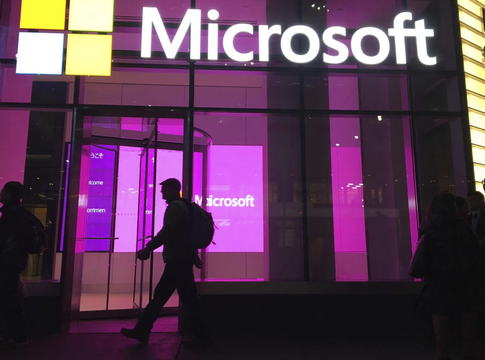 "FILE - In this Nov. 10, 2016, photo, people walk near a Microsoft office in New York. Microsoft says Iranian hackers have posed as conference organizers in Germany and Saudi Arabia in an attempt to spy on ""high-profile"" people using spoofed email invitations. The tech company said Wednesday, Oct. 28, 2020, it detected attempts by the hacking group it calls Phosphorus to trick former government officials, policy experts and academics. (AP Photo/Swayne B. Hall)"