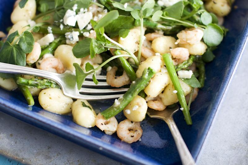 In this image taken on March 18, 2013, spring gnocchi with asparagus and shrimp is shown in a serving dish in Concord, N.H. (AP Photo/Matthew Mead)