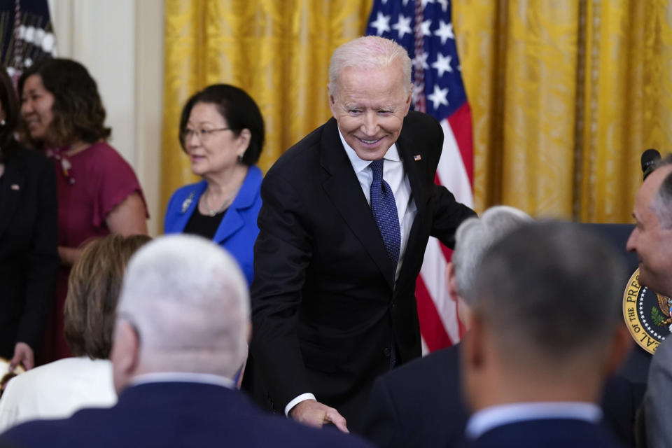 President Joe Biden talks with House Speaker Nancy Pelosi of Calif., after signing the COVID-19 Hate Crimes Act, in the East Room of the White House, Thursday, May 20, 2021, in Washington. (AP Photo/Evan Vucci)