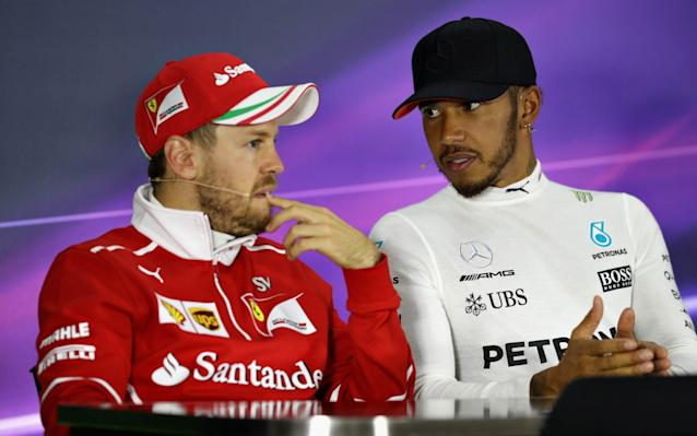 <span>Vettel and Hamilton post-Chinese Grand Prix</span> <span>Credit: Getty Images </span>