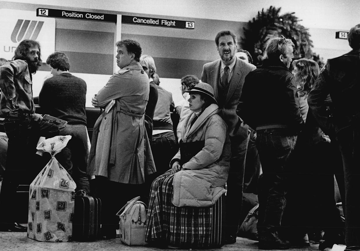 Just for special snow days, United Airlines now has signs and lines to handle passengers with cancelled flights. They had four lines going and about six agents handling the frustrated travelers on Nov. 12, 1984.