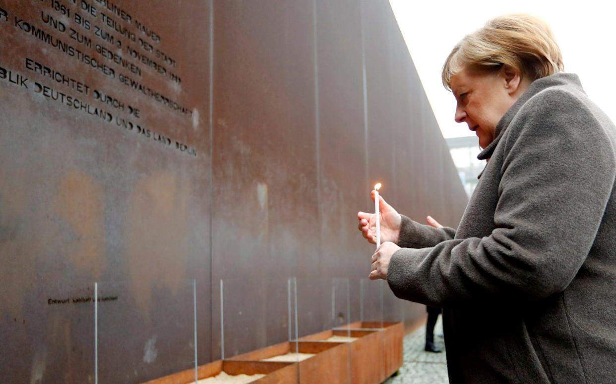 Angela Merkel appealed for European leaders to defend democracy and freedom as Germany marked 30 years since the fall of the Berlin Wall - REUTERS