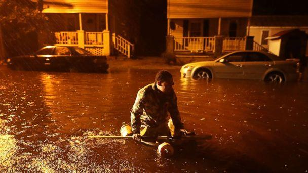 PHOTO: Michael Nelson floats in a boat made from a metal tub and fishing floats after the Neuse River went over its banks and flooded his street during Hurricane Florence Sept. 13, 2018 in New Bern, N.C. (Chip Somodevilla/Getty Images)