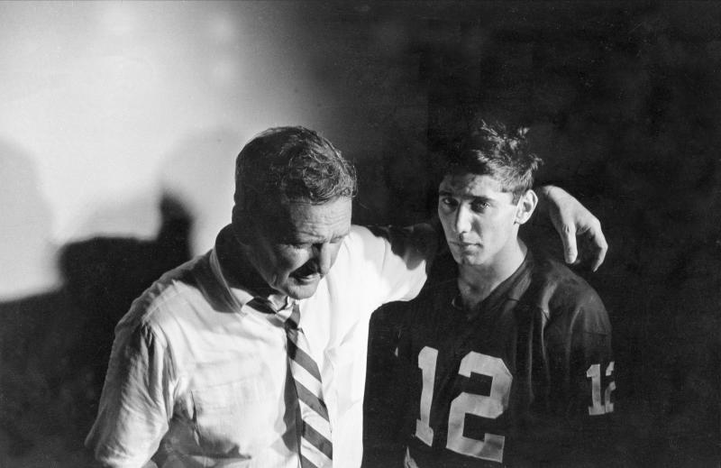 FILE - In this Jan. 1, 1965, file photo, Alabama coach Paul Bryant puts his arm around quarterback Joe Namath in the dressing room after losing to Texas in the Orange Bowl NCAA college football game in Miami. Alabama (10-1), led by Namath, was named No. 1 in both the AP and coaches poll at the end of the regular season. Notre Dame was ranked No. 1 for the last month of the season, but was upset in the season finale by Southern California. (AP Photo/File)