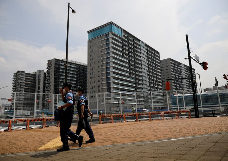 Police officers patrol outside the Athletes Village ahead of Tokyo 2020 Olympic Games in Tokyo