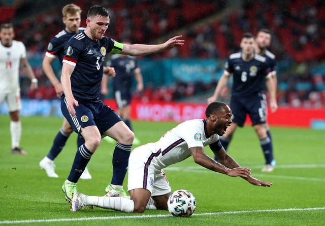 The VAR did not recommend a review of this challenge by Andrew Robertson, left, on Raheem Sterling because it was felt the contact was marginal