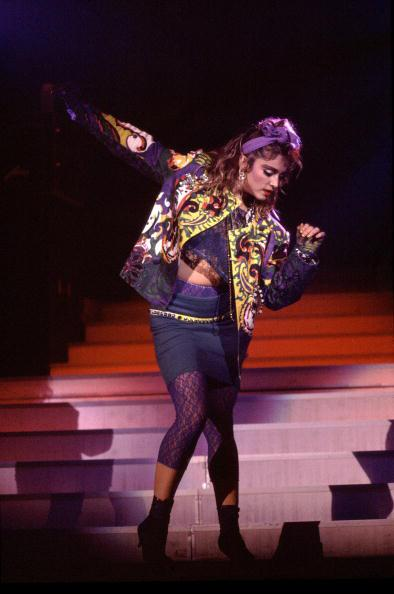 "<div class=""caption-credit""> Photo by: Getty Images</div><div class=""caption-title""></div><b>Busting a move in Chicago, 1985</b> <br> Madonna's signature '80s look often featured lace leggings, hair bows, and lots of mismatched, textured layers. Many women tried to copy it then, and some still do today!"