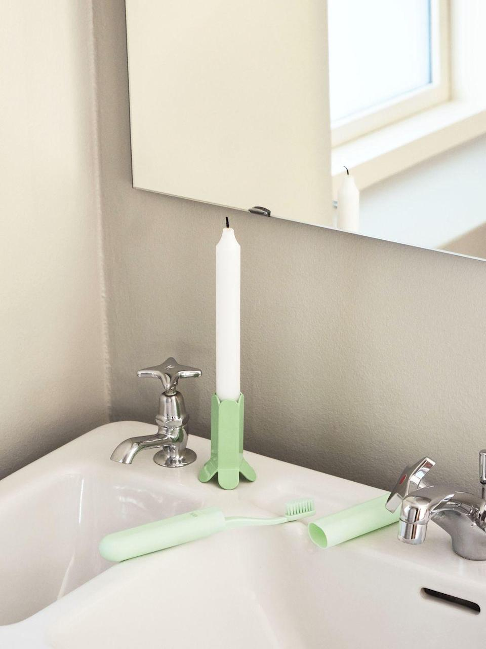"""<p>It's the totally on-trend 'Soft Mint' colour of these two accessories by Muller Van Severen and Andreas Engesvik for Danish brand Hay that sets them apart – part 1950s ice cream parlour chic, part contemporary scandi charm. A subtle way to brighten up an all-white room. Toothbrush, £3.36; candleholder, £29.41, <a href=""""https://www.connox.co.uk/categories/accessories/decoration/candlestick/hay-arcs-candle-holder.html?itm=189681"""" rel=""""nofollow noopener"""" target=""""_blank"""" data-ylk=""""slk:connox.co.uk"""" class=""""link rapid-noclick-resp"""">connox.co.uk</a></p>"""