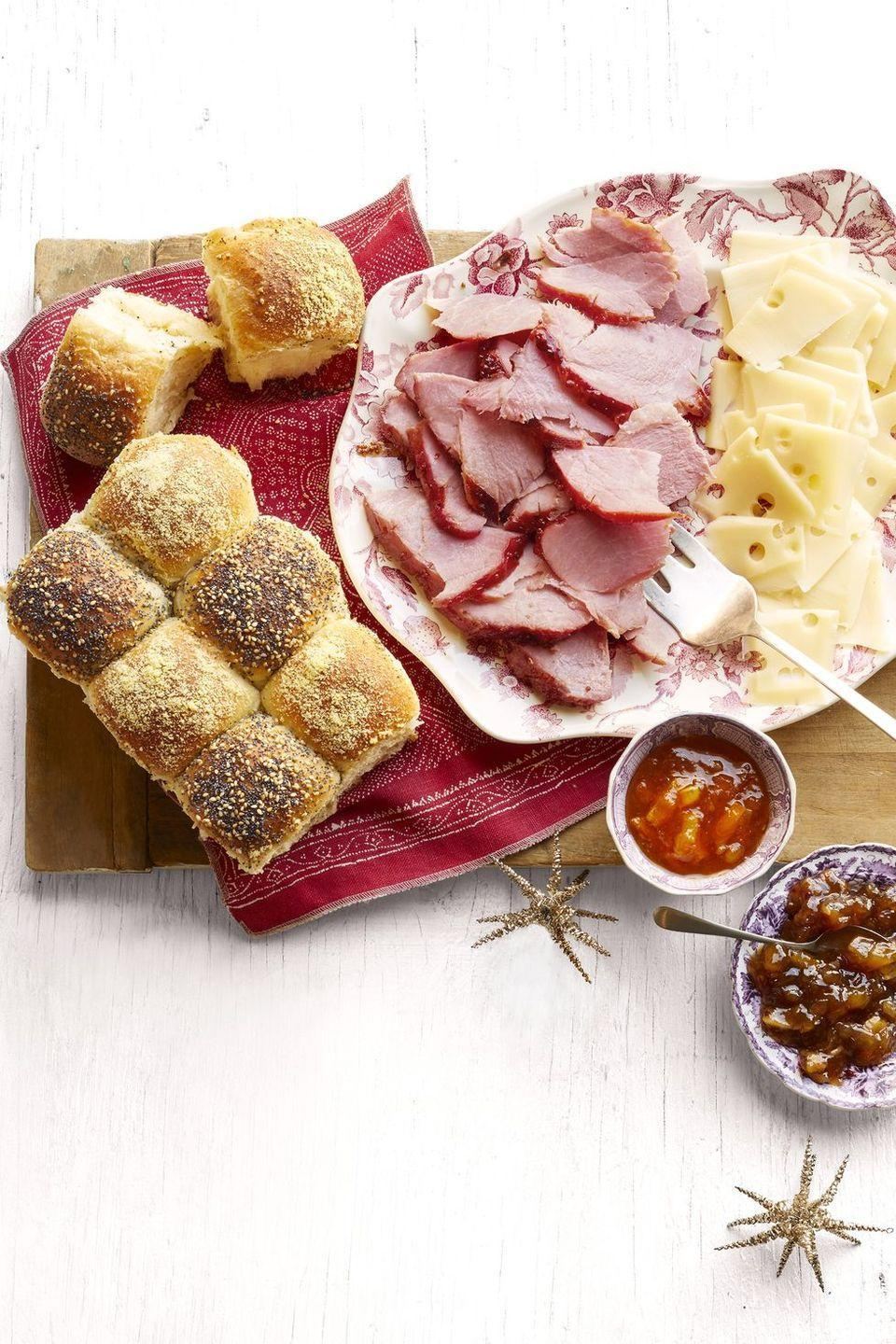 """<p>Turn Thanksgiving ham into a holiday appetizer that's perfect for potlucks and Friendsgiving. Serve it with cheese, jams, and mini sliders. </p><p><a href=""""https://www.thepioneerwoman.com/food-cooking/recipes/a34271871/honey-glazed-ham-and-checkerboard-rolls-recipe/"""" rel=""""nofollow noopener"""" target=""""_blank"""" data-ylk=""""slk:Get Ree's recipe."""" class=""""link rapid-noclick-resp""""><strong>Get Ree's recipe.</strong></a></p>"""
