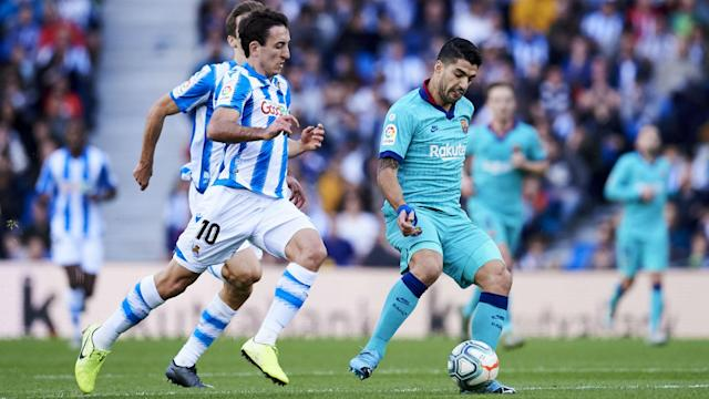 Luis Suarez helped Barcelona to come from behind at Real Sociedad and lead, but Ernesto Valverde's men could not secure victory.