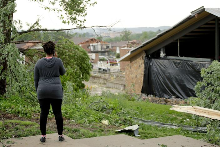A woman surveys damage on May 23, 2019 after a tornado tore though Jefferson City, Mo. late May 22, 2019. (Photo: Charlie Riedel/AP)