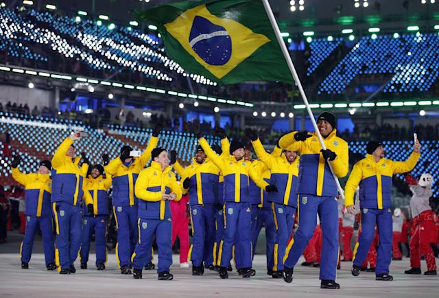 <p>Edson Bindilatti carries the flag of Brazil during the opening ceremony of the 2018 Winter Olympics in Pyeongchang, South Korea, Friday, Feb. 9, 2018. (AP Photo/Jae C. Hong) </p>
