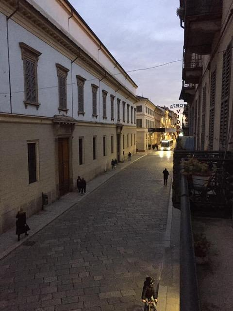 This street in Pavia would usually be packed at the time of day in the photo – late afternoon – but only a handful of pedestrians are out in lockdown.
