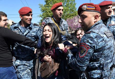A demonstrator is detained by police during a protest against Armenia's ruling Republican party's nomination of former President Serzh Sarksyan as its candidate for prime minister, in Yerevan, Armenia April 16, 2018. Photolure/Hayk Baghdasaryan via REUTERS