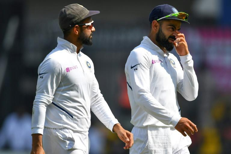 India captain Virat Kohli (right) is being put under pressure by the quiet efficiency of stand-in skipper Ajinkya Rahane (left)
