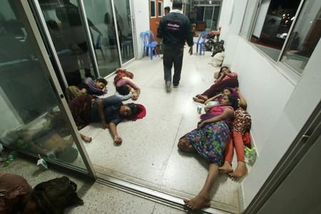 Rohingya people are seen detained in a police station after a fishing boat carrying more than sixty Rohingya refugees was found beached at Rawi island