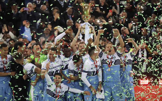 Lazio's Senad Lulic holds up with his teammates the Italian Cup trophy at the end of the final match between Lazio and Atalanta, at the Rome Olympic stadium, Wednesday, May 15, 2019. Lazio won 2-0. (AP Photo/Alessandra Tarantino)
