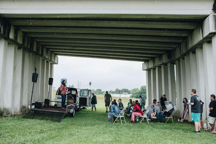 """Pastor Cody Howard delivers a sermon to attendees of Church Under the Bridge<span class=""""copyright"""">Khadija Farah for TIME</span>"""