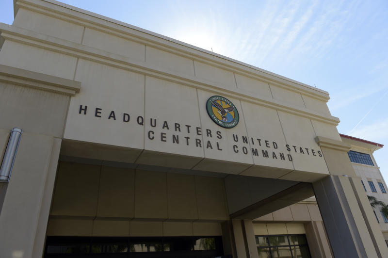 This Feb. 6, 2017 file photo shows the U.S. Central Command at MacDill Air Force Base in Tampa, Fla.  A Navy sailor assigned to United States Central Command headquarters in Florida has tested positive for the novel coronavirus. CENTCOM spokesman Capt. Bill Urban made the announcement in a news release Saturday, March 21, 2020. . Urban says the sailor returned to the U.S. from overseas travel on March 15, and went into precautionary quarantine at his home.  (AP Photo/Susan Walsh, File)