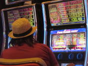 A woman plays a slot machine at the Hard Rock casino in Atlantic City N.J., on Monday, June 28, 2021. Hard Rock last year finished second only to the Borgata in terms of money won from in-person gamblers. (AP Photo/Wayne Parry)