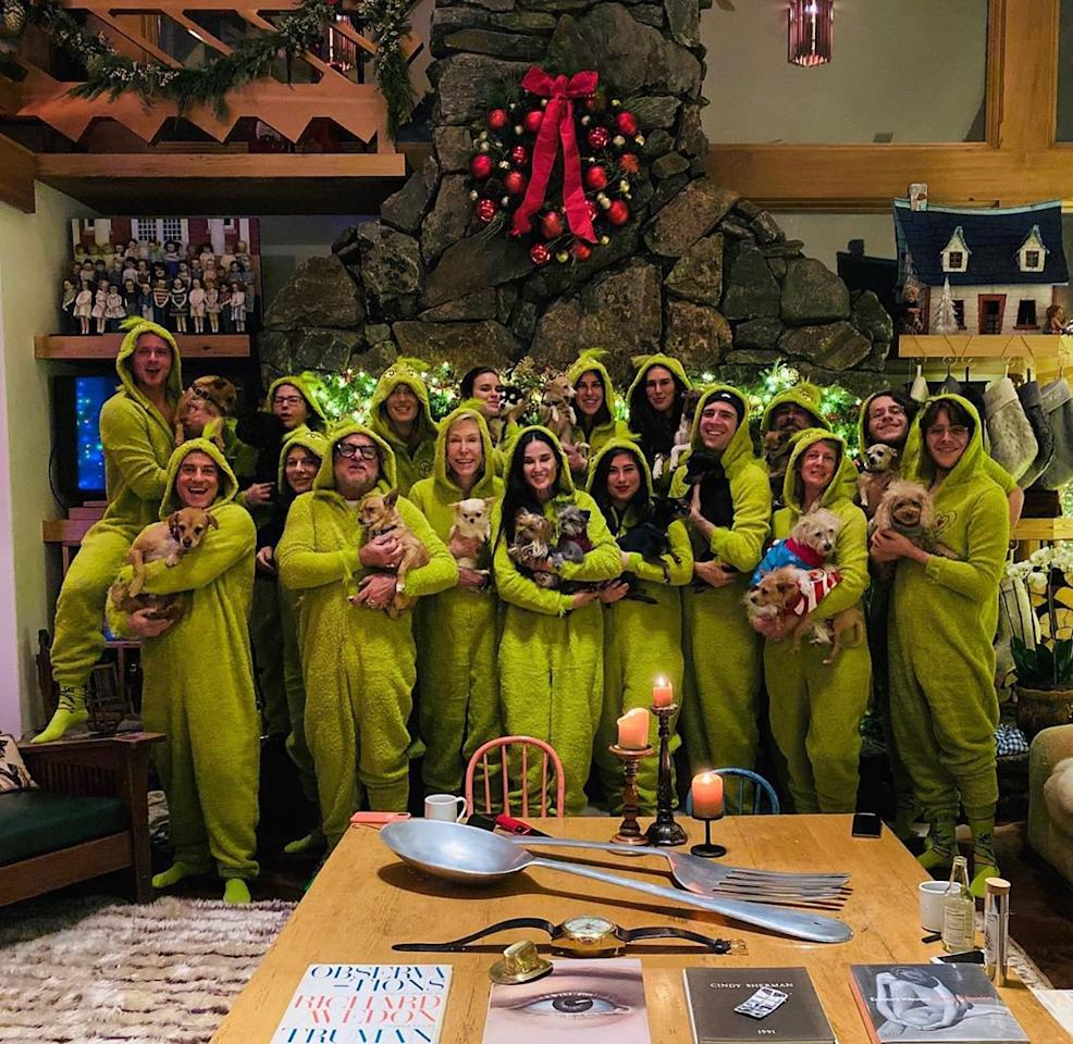 """The<em>Inside Out</em>author's Christmas celebrations included their annual tradition of matching pajamas. Moore's daughter, Scout, <a href=""""https://www.instagram.com/p/B6fGBHzFMd4/"""">wrote on Instagram</a>, """"This year's surprise Christmas pajamas revealed!!! Grinch onsies for one and all! Not one too big and not one too small!!"""""""