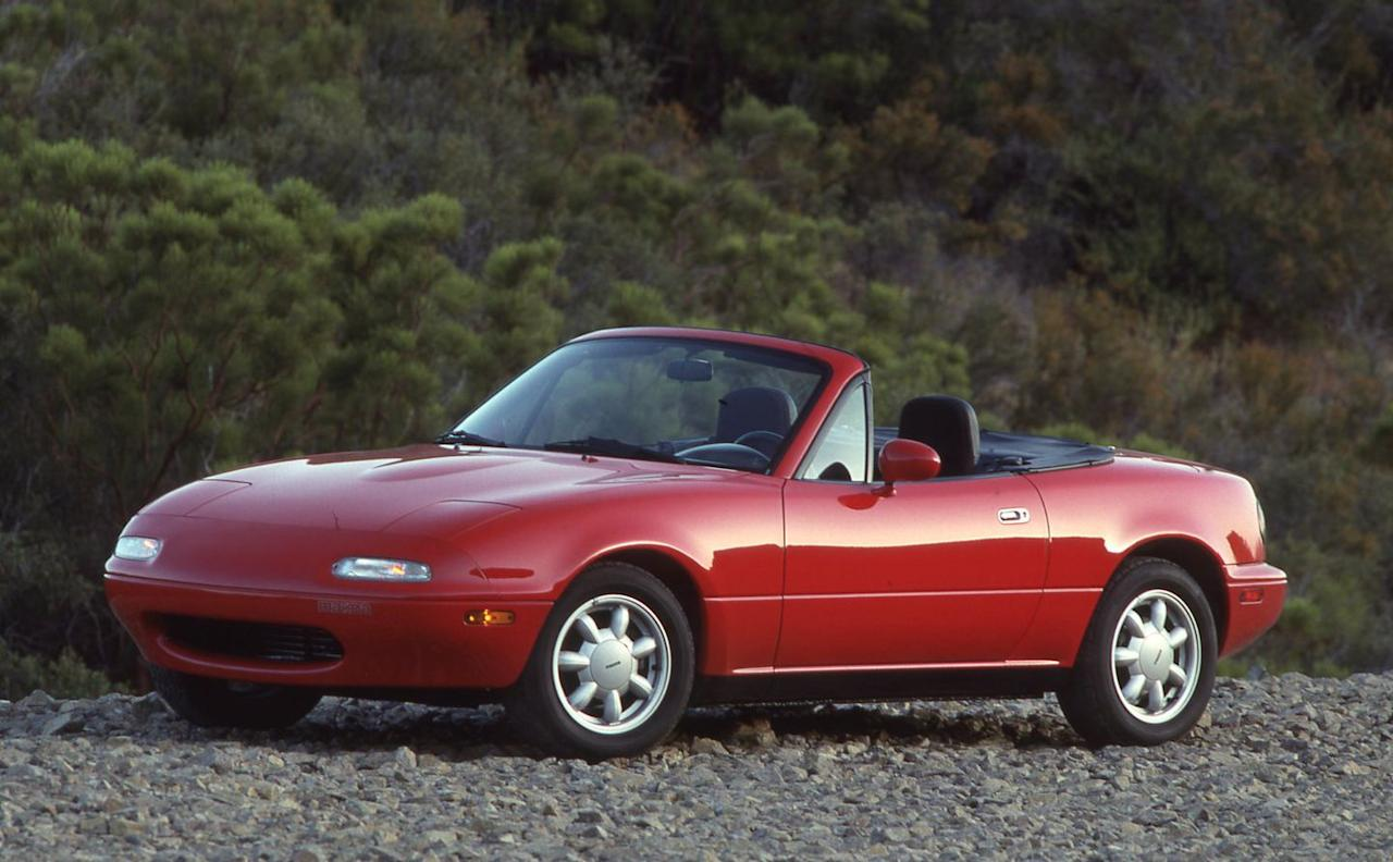 <p>At launch, the MX-5 Miata is powered by a 116-hp 1.6-liter engine and is available solely with a five-speed manual transmission. Niceties such as power windows and aluminum wheels are optional, and no matter how it's equipped, the Miata is extremely lightweight by modern standards. Only three colors are offered initially: blue, red, and white; later, Mazda adds a Silver Stone metallic. </p>
