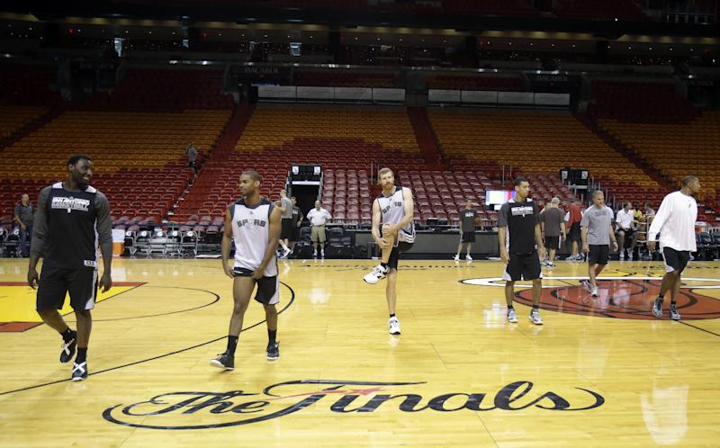 San Antonio Spurs players stretch during NBA basketball practice, Wednesday, June 19, 2013, at the American Airlines Arena in Miami. The Spurs take on the Miami Heat in Game 7 of the NBA Finals on Thursday in Miami. (AP Photo/Wilfredo Lee)