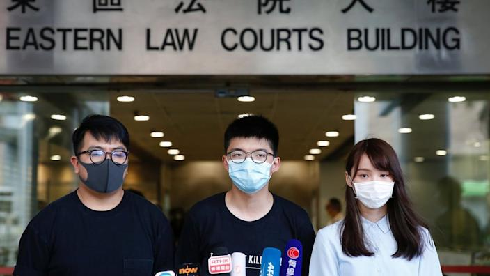 Joshua Wong, centre, appeared in court with fellow activists Ivan Lam and Agnes Chow