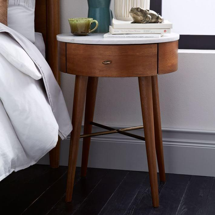 <p>The marble top of this <span>West Elm Penelope Nightstand</span> ($399 - $798) makes it look modern, while the round drawer provides amply storage space.</p>