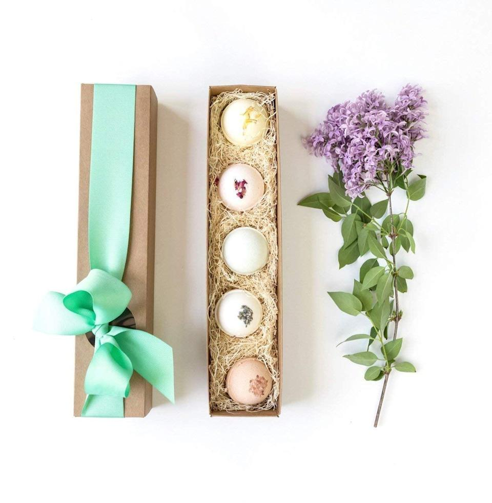 """<p>Get them to relax and take some well-deserved """"me-time"""" with the <span>Bath Bomb Gift Set of 5 by The Little Flower Soap Co</span> ($18). The bath bombs feature lavender, lemongrass, eucalyptus, pink grapefruit, and rosewood scents.</p>"""