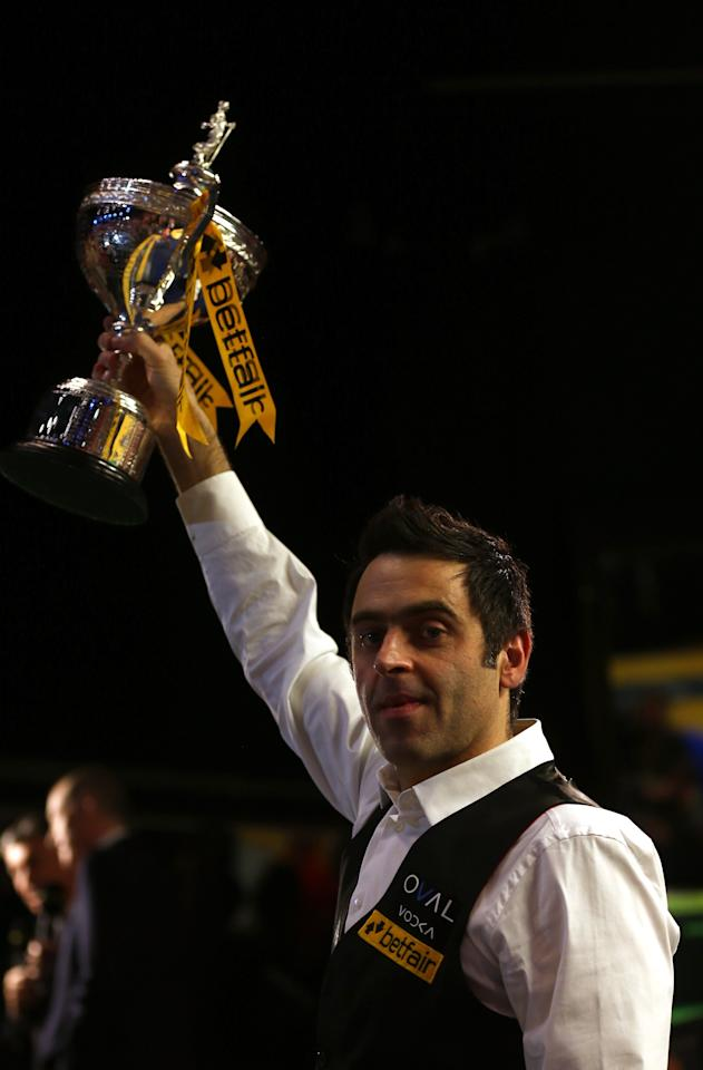 SHEFFIELD, ENGLAND - MAY 06:  Ronnie O'Sullivan of England poses with the trophy after beating Barry Hawkins of England to win the Betfair World Snooker Championship at the Crucible Theatre on May 6, 2013 in Sheffield, England.  (Photo by Warren Little/Getty Images)